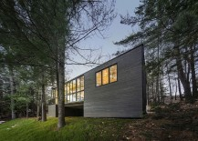 Smart exterior of the cabin blends visuall with the landscape around it
