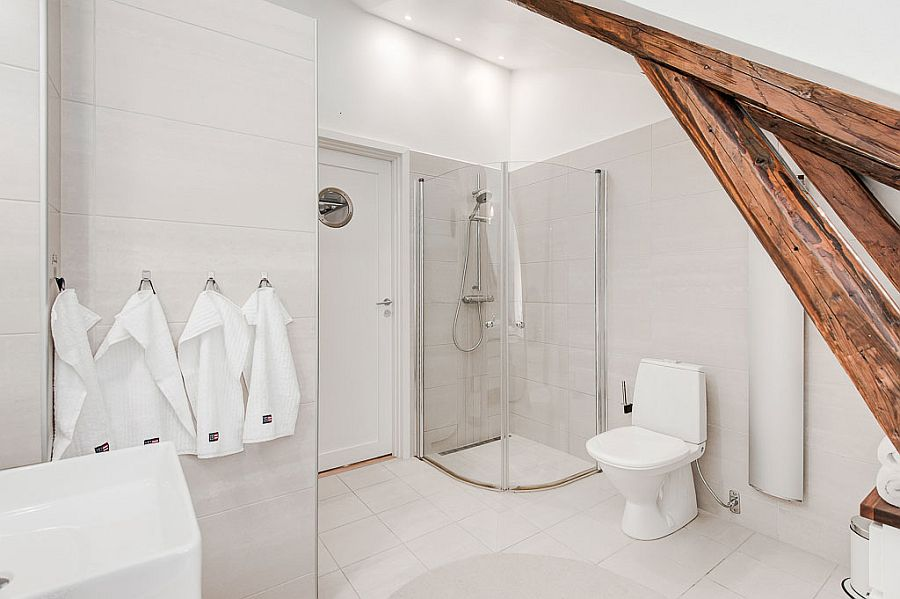 Smart white bathroom with a space-conscious design and corner shower