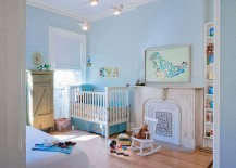 Soothing nursery in light blue with custom wall art
