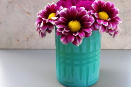 Spring arrangement of daisies and a carnation