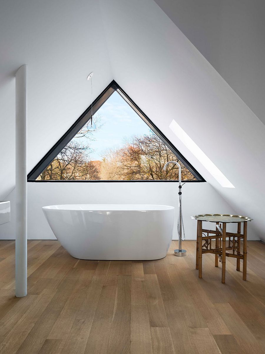 Standalone bathtub in the attic bathroom