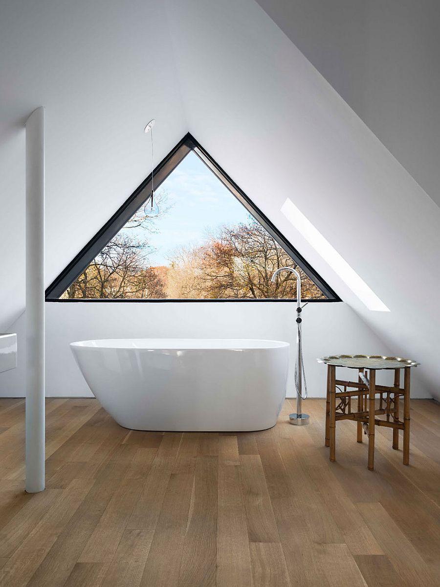 Standalone bathtub in the attic bathroom
