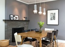 Stylish chairs and a gorgeous gray backdrop shape the contemporary dining room