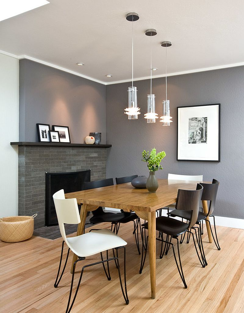 Stylish chairs and a gorgeous gray backdrop shape the contemporary dining room [Design: ONEinteriors]
