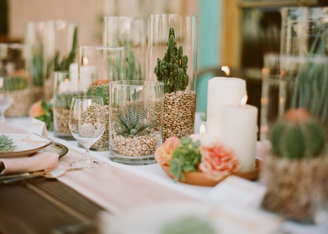 Succulents and candles create a table runner from Green Wedding Shoes
