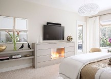 TV above the fireplace in the bedroom