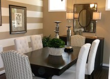 Traditional dining room with a striped accent wall
