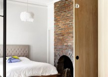 Unique brick wall in the bedroom with fireplace