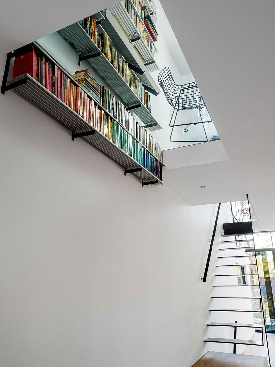 Unique home library on the top level adds color to the space