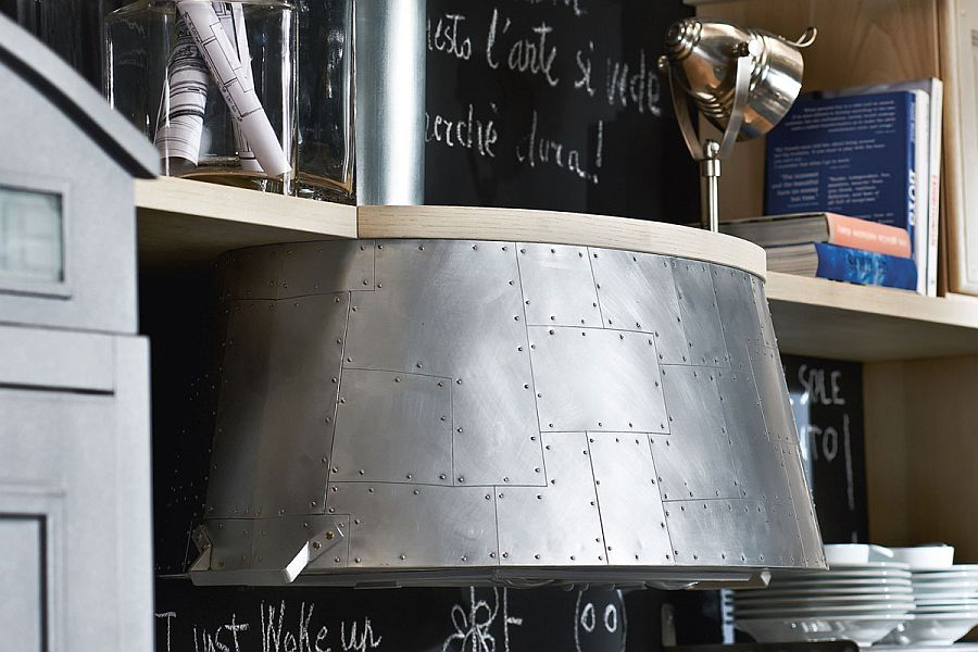 Unique hood of the kitchen worktop is inspired by world war II war plane grills