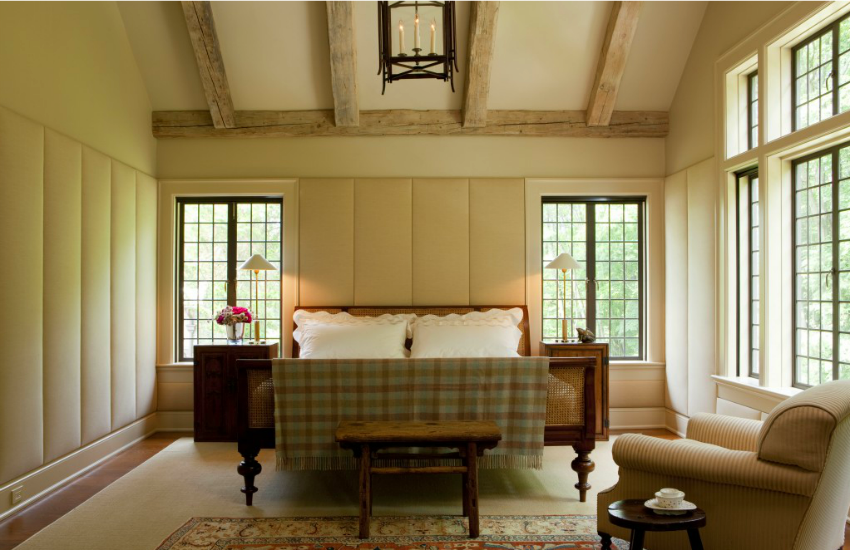 Notice that the walls here are upholstered both behind the bed, and also the side walls