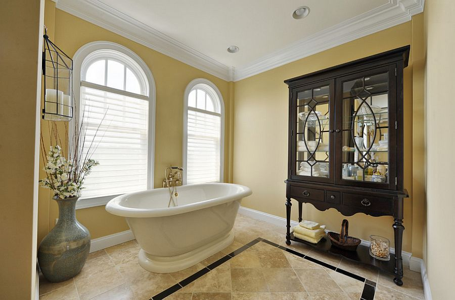 Use yellow to create a lovely backdrop for your traditional bathroom [Design: Echelon Custom Homes]
