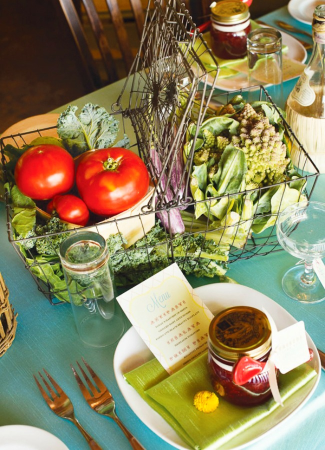 Luscious tomatoes and seasonal greens make a lovely (and edible) centerpiece  Green and Gorgeous Garden-Inspired Table Settings Vegetable Table Setting