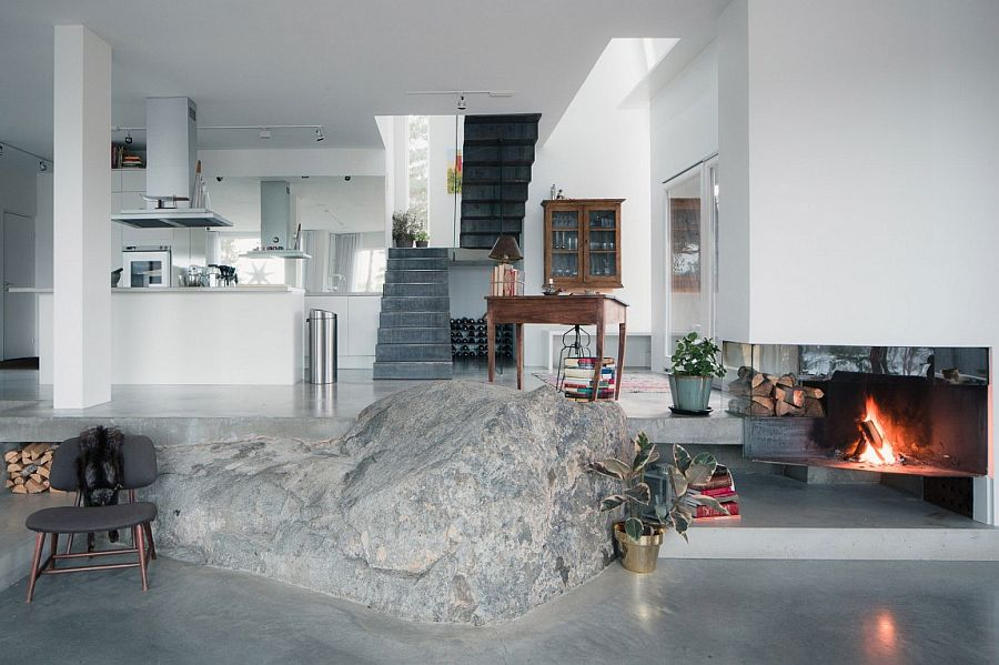 View of the kitchen and the staircase from the living area