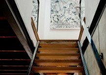 Wall-art-adds-a-hint-of-playful-charm-to-the-staircase-landing-217x155