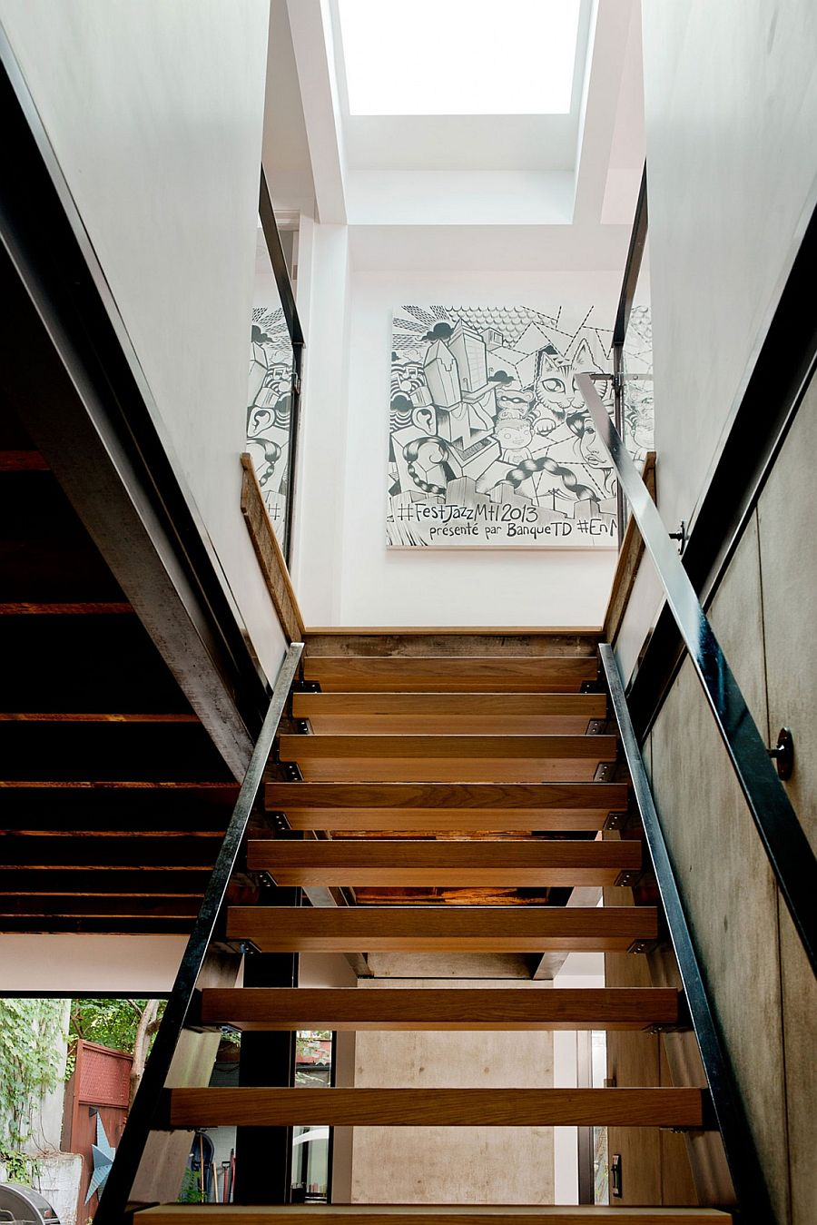 Wall art adds a hint of playful charm to the staircase landing