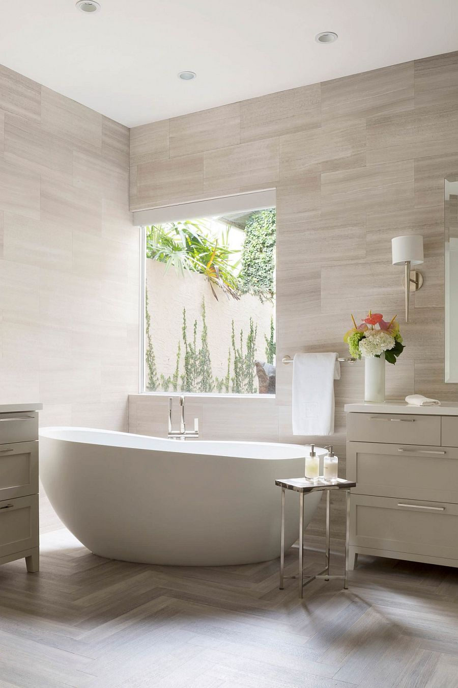 Wall tiles add texture to the serene, contemporary bathroom