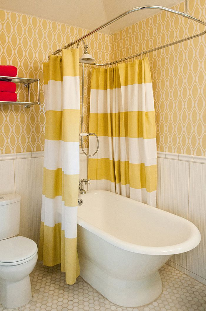 Wallpaper and shower curtains bring yellow to the small bathroom [Design: Room Fu - Knockout Interiors]