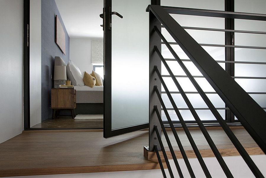Walnut staircase leads to the master bedroom on the top level