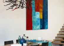 Walnut table and brilliant wall art in the dining room
