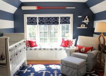 White and dark blue stripes along with decor usher in the nautical look