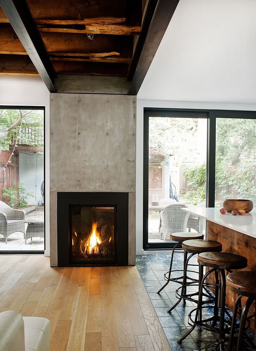 Wooden ceiling beams and flooring shape the living area