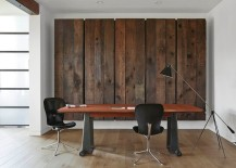 Wooden panels conceal a large Murphy bed behind them in this contemporary home office