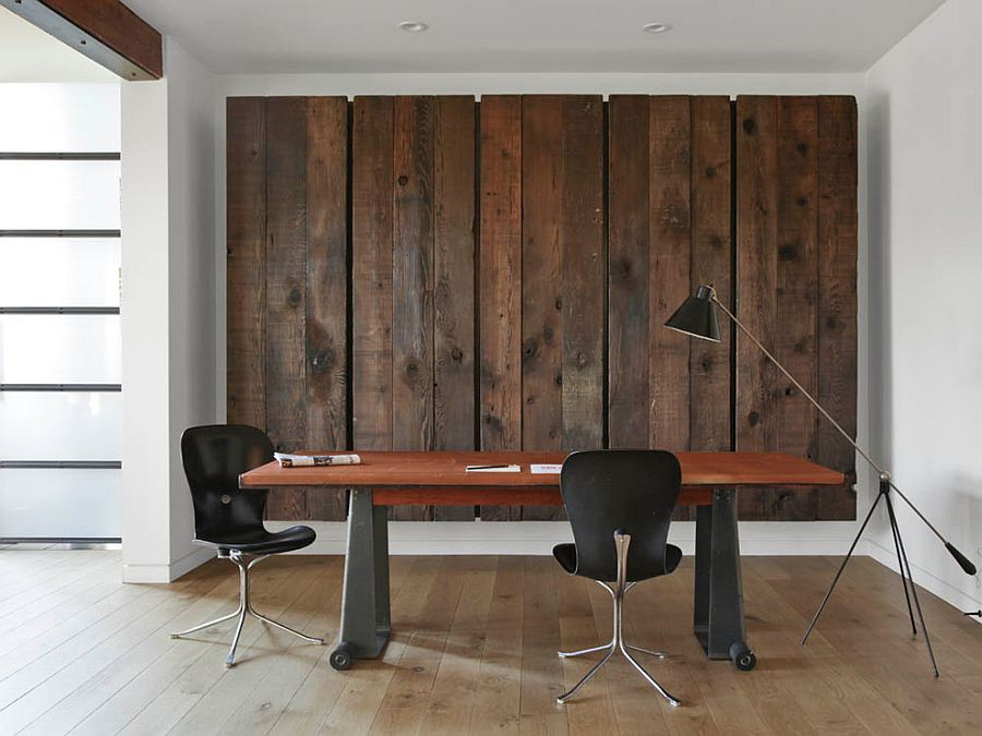 Wooden panels conceal a large Murphy bed behind them! [Design: Union Studio]