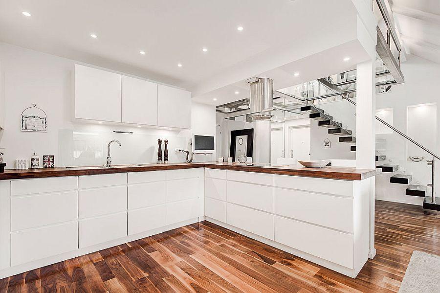 Wooden worktops in the kitchen offer elegant visual contrast