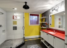 Yellow brings visual brightness to the posh gray bathroom