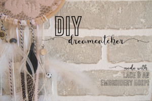 A DIY dreamcatcher made out of an embroidery hoop