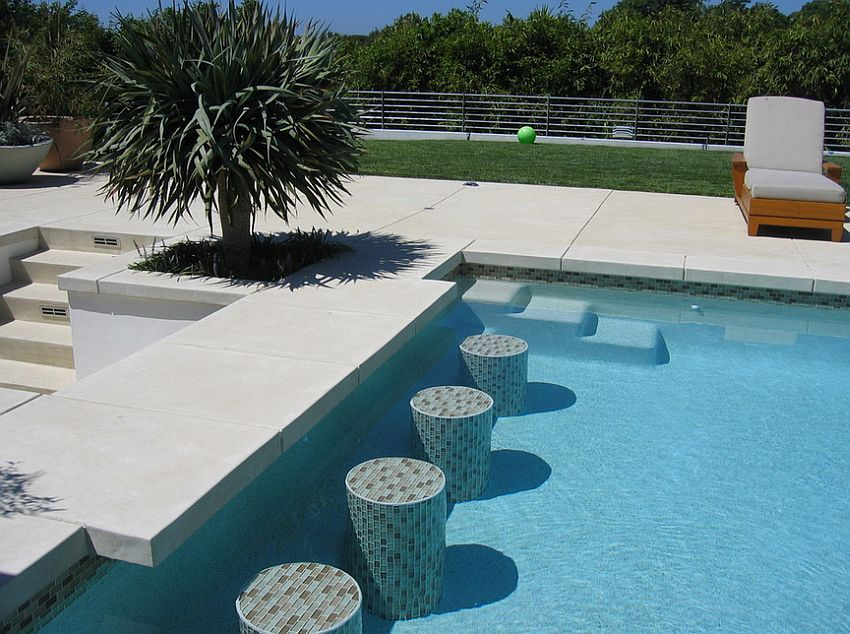 Acid etch finish concrete shapes this elegant pool deck and additional features [Design: Sage Design Studios]