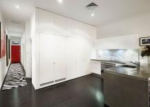 All white kitchen design with a stylish marble backsplash