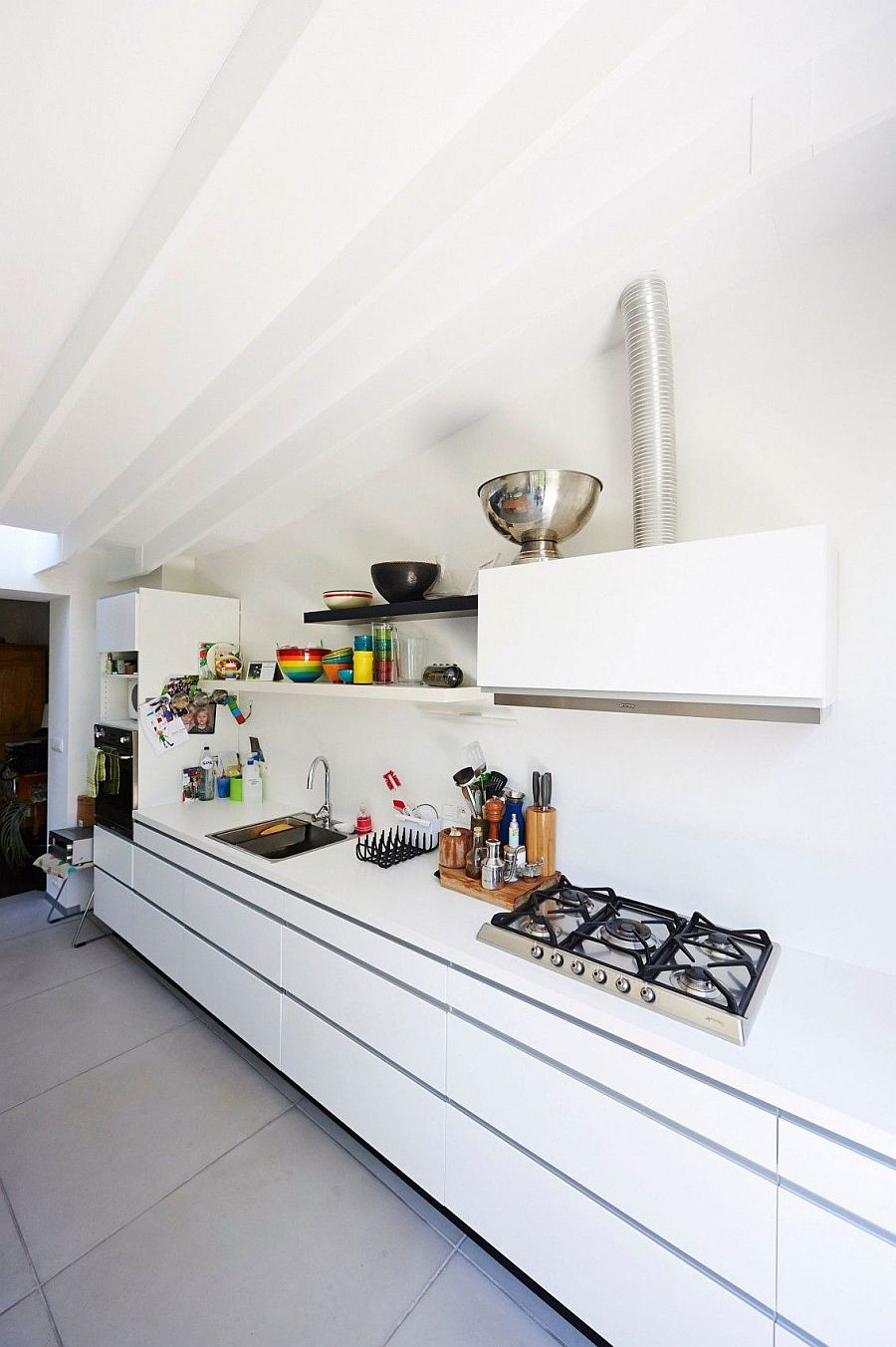 All-white kitchen workstation with a hint of black