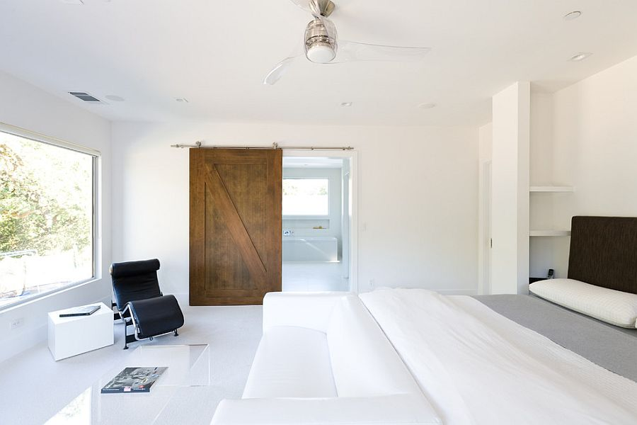 All White Minimal Bedroom With A Lovely Barn Door For The