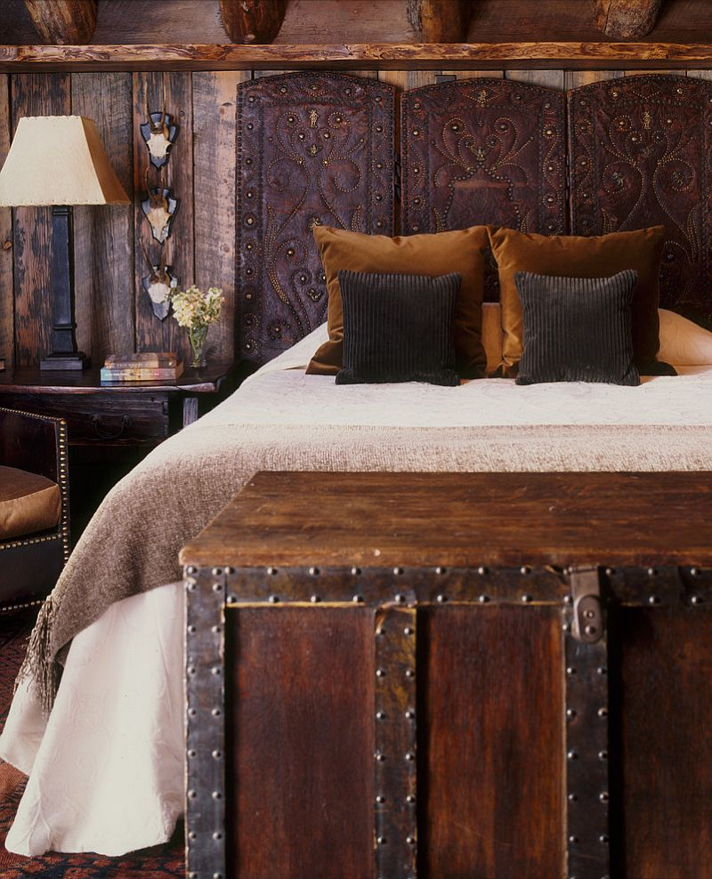 Antique screen turned into a lovely headboard in the rustic room [Design: Peace Design]