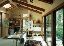Art studio and home office connected with the outdoors through glass doors