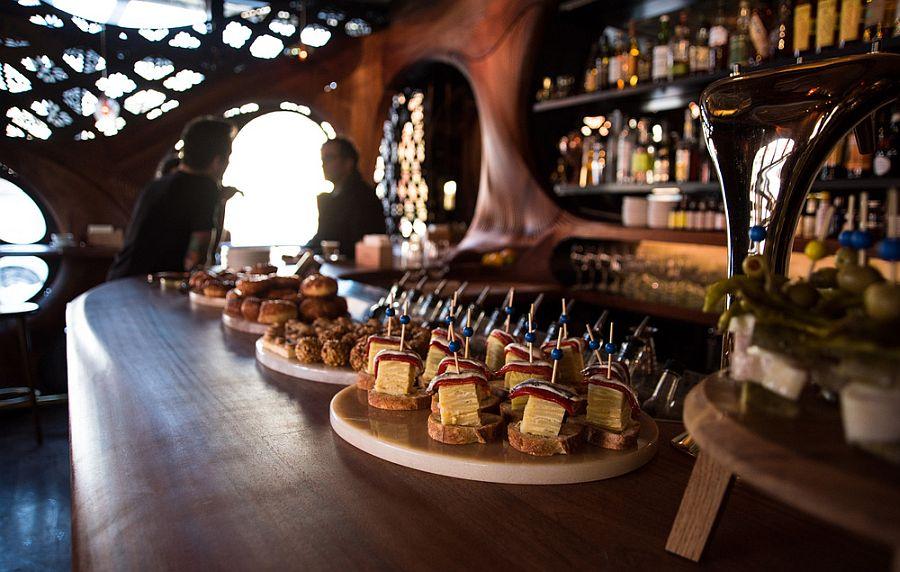 Bar Raval Toronto steals the show with its CNC'd mahogany interior