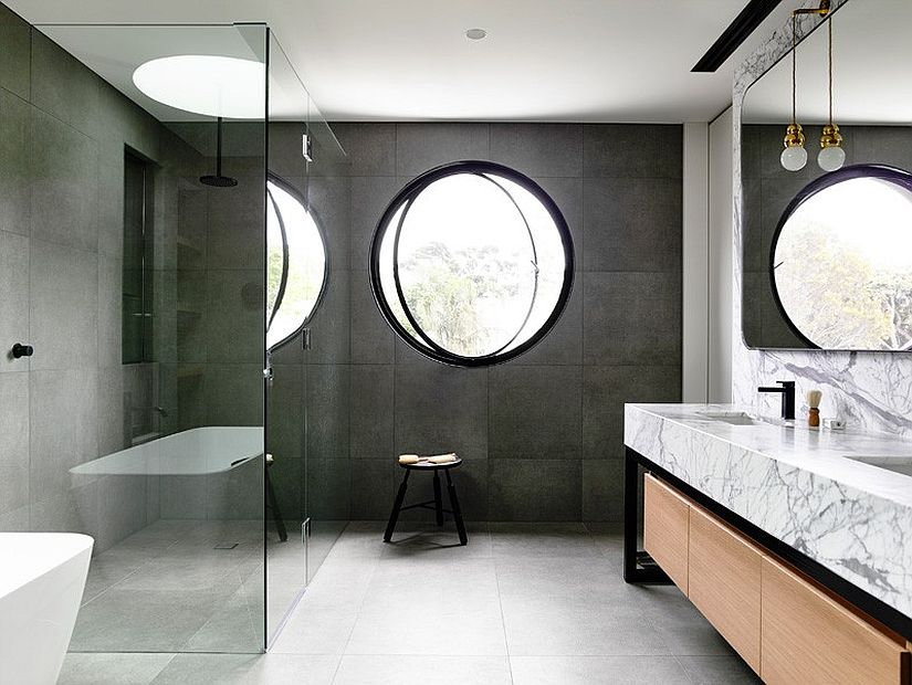 Bathroom with a minimal industrial style fetaures a marble vanity