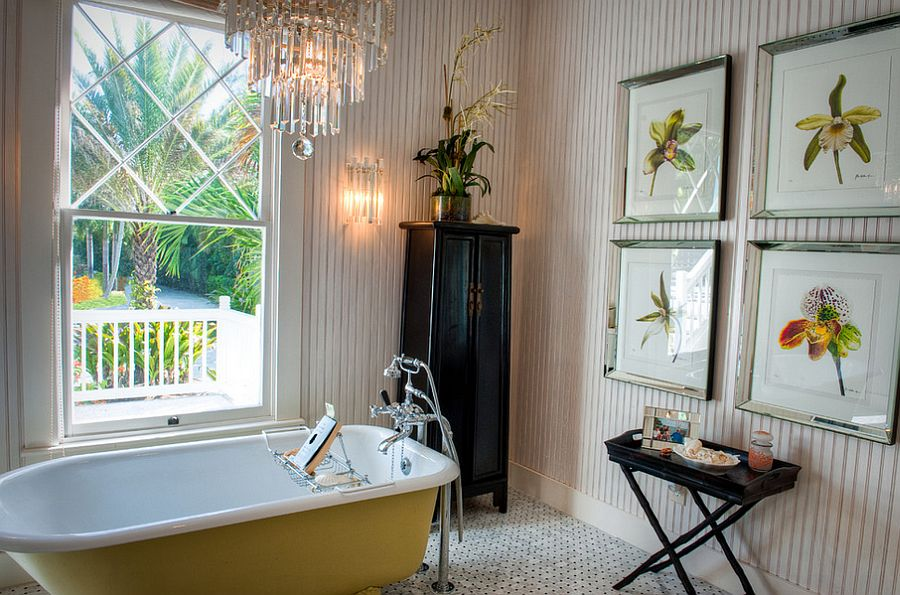 Beach cottage bathroom with yellow claw-foot bathtub and a chandelier [Design: GH3 Enterprises LLC]