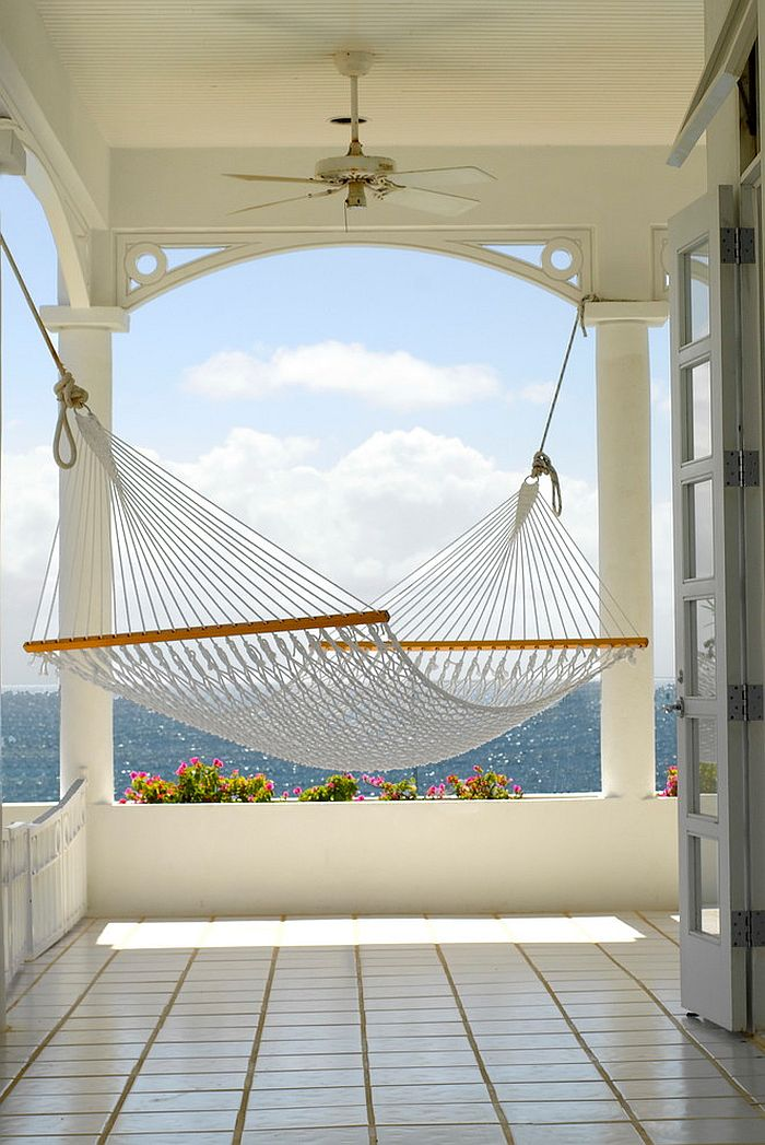 Beach style porch with hammock overlooking the ocean