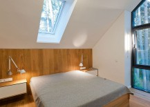 Bedroom-on-top-floor-overlooking-the-forest-landscape-outside-217x155