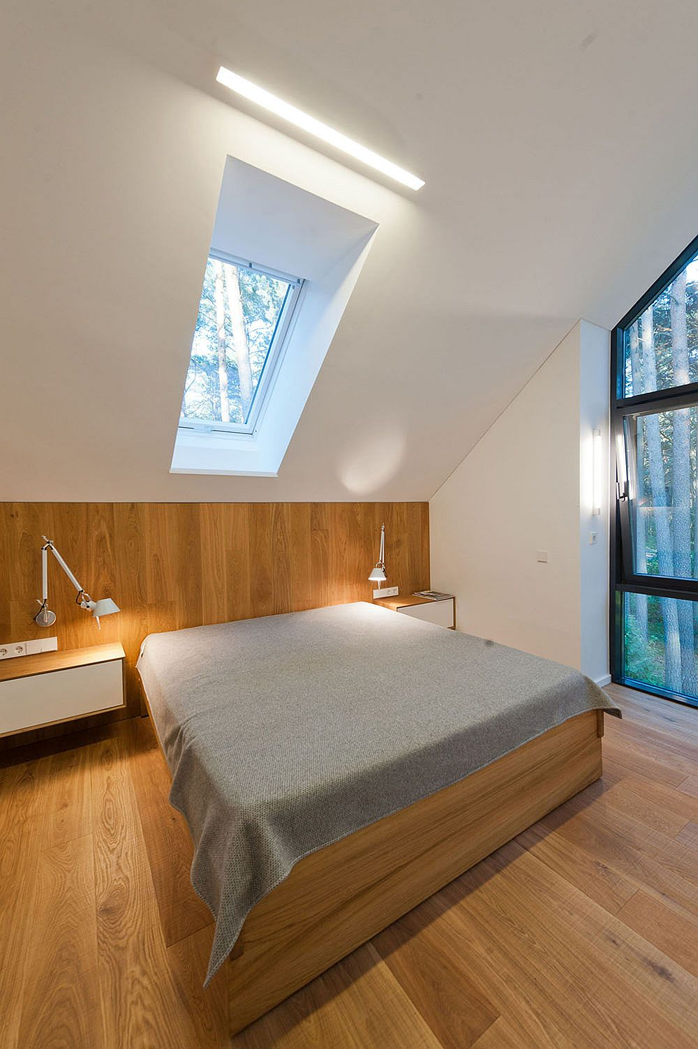 Bedroom on top floor overlooking the forest landscape outside