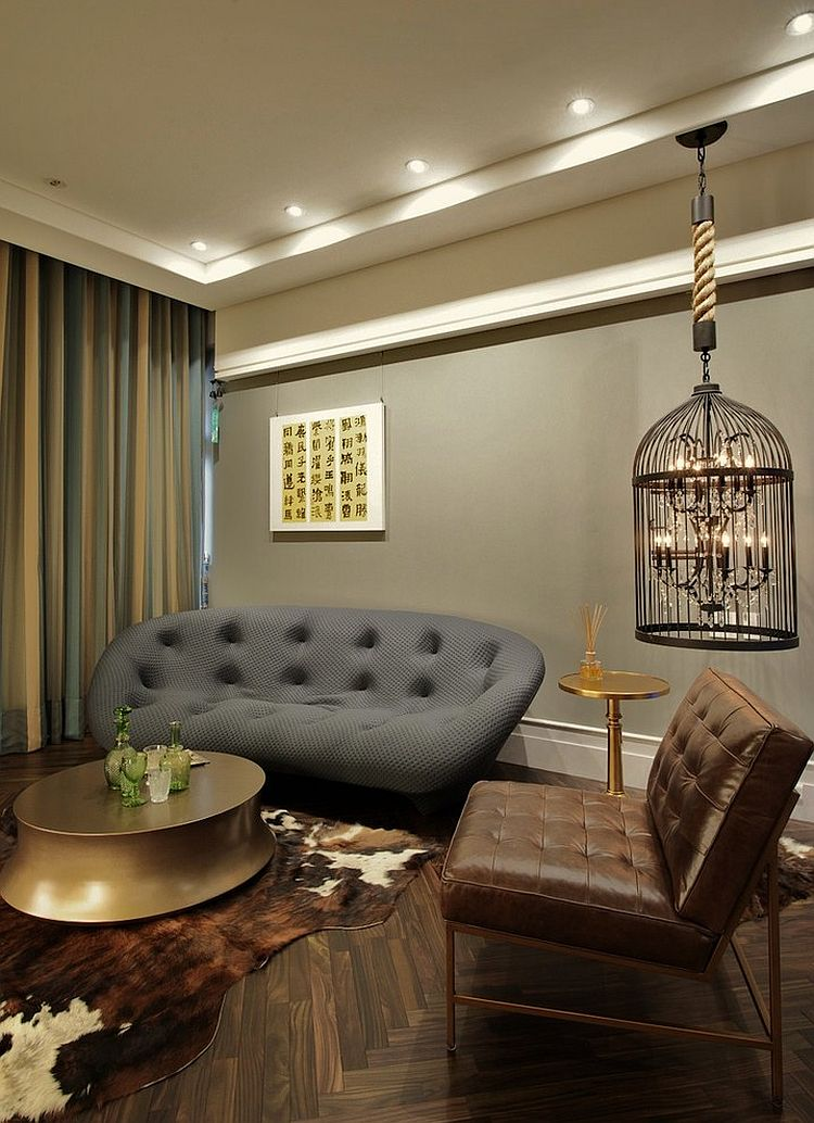 Birdcage with candles used as a decorative element in the living room [Design: Plan Design Group]