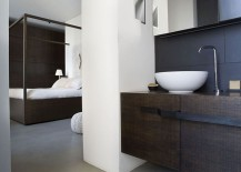 Black and white bathroom complements the color scheme of the bedroom