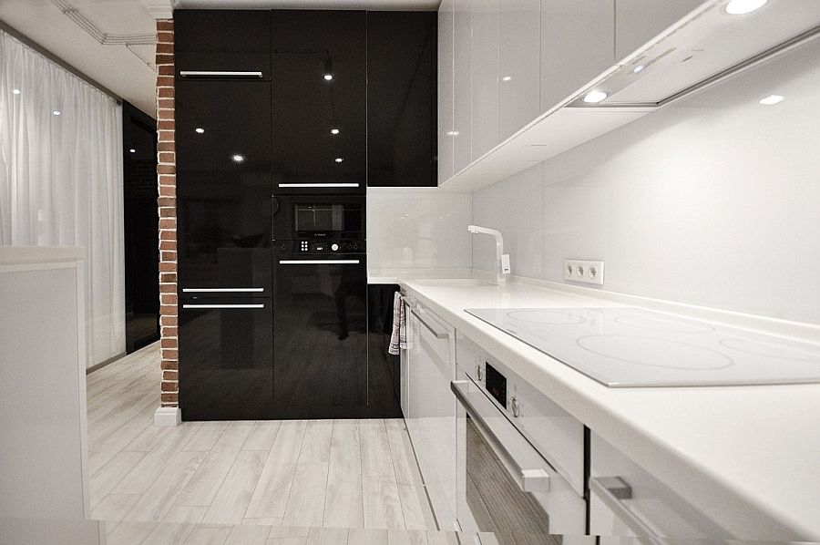 Black and white kitchen design with glossy finishes