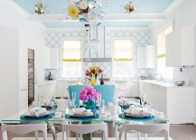 Blue ceiling adds to the appeal of the exquisite contemporary dining space