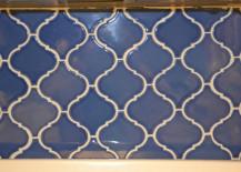 Blue-patterned-tile-backsplash-DIY-217x155