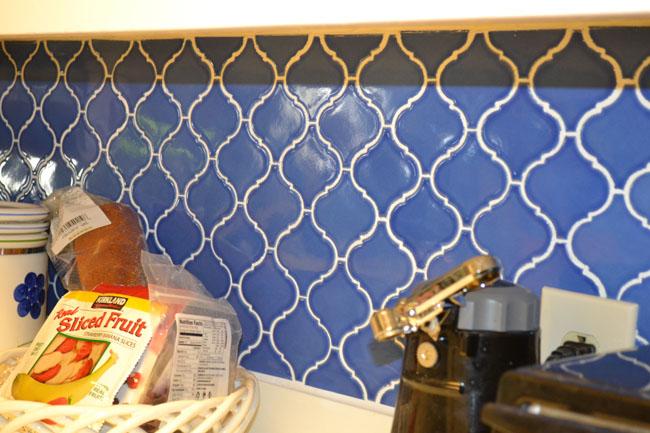 Blue patterned tile backsplash