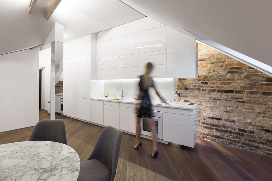 Brick wall adds an interesting visual to the modern attic apartment